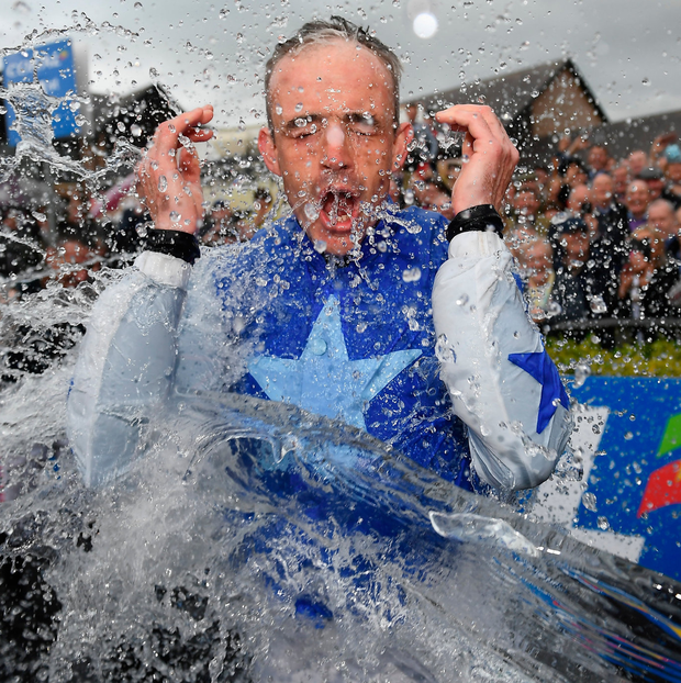 Ruby Walsh goes out with a splash as he is soaked by fellow jockeys after announcing his retirement from racing only minutes after steering Kemboy to victory in the Punchestown Gold Cup at yesterday. Photo: David Fitzgerald/Sportsfile
