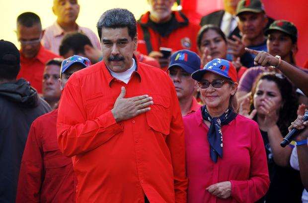 Venezuela's President Nicolas Maduro and his wife Cilia Flores attend a rally in support of his government and to commemorate May Day in Caracas Venezuela, May 1, 2019. REUTERS/Fausto Torrealba