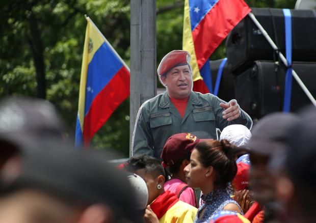 A life-size cardboard cutout of late Venezuelan President Hugo Chavez stands amidst the crowd during a rally in support of Venezuela's President Nicolas Maduro's government and to commemorate May Day in Caracas, Venezuela, May 1, 2019. REUTERS/Carlos Eduardo Ramirez