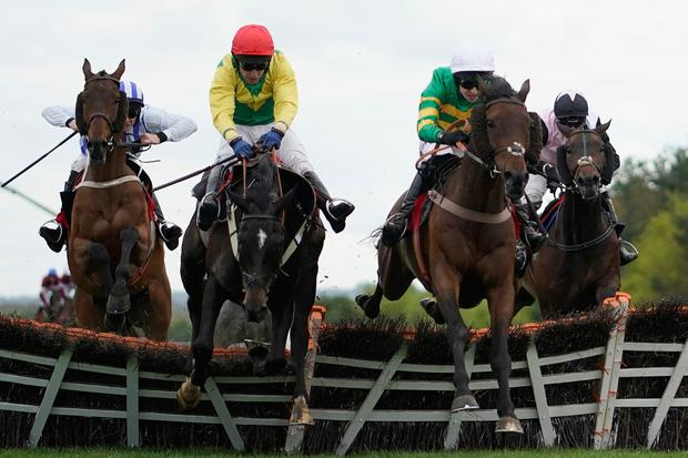 Mark Walsh riding Unowhatimeanharry (green) clear the last to win The Ladbrokes Champion Stayers Hurdle at Punchestown