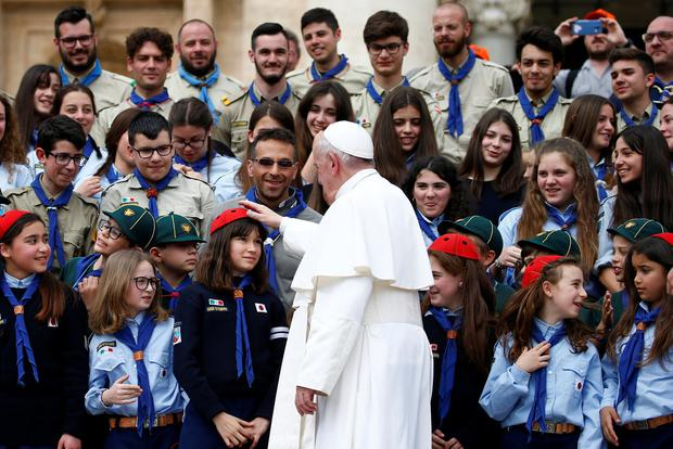 Pope Francis greets a child during the weekly general audience at the Vatican. Photo: Reuters