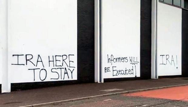 Threat: The graffiti sprayed on the wall in Creggan, Co Derry. Photo: PA