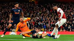 Arsenal's Alexandre Lacazette (R) has this shot blocked by Valencia defender Gabriel Paulista during last night's Europa League semi-final first leg at the Emirates. Photo: AFP