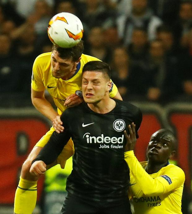 Luka Jovic in action with Chelsea's Andreas Christensen and N'Golo Kante. Photo: Kai Pfaffenbach/Reuters