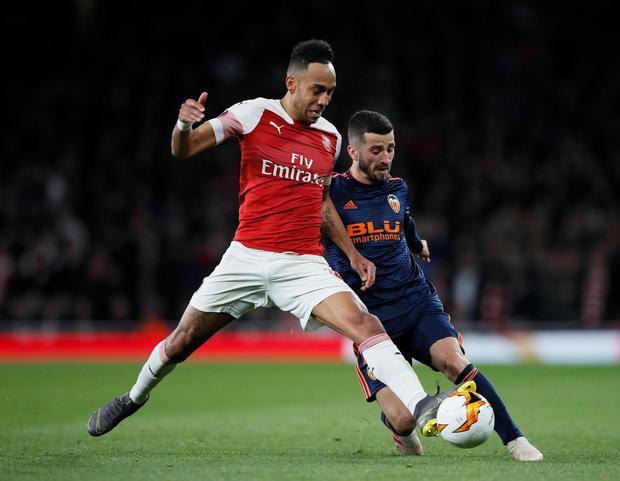 Valencia's Jose Gaya in action with Arsenal's Pierre-Emerick Aubameyang. Photo: David Klein/Reuters