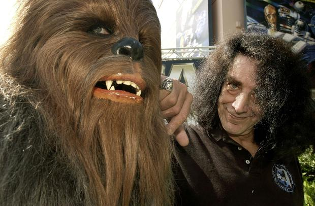 May the force be with you: Actor Peter Mayhew poses alongside his Chewbacca character at MGM Studios in Florida
