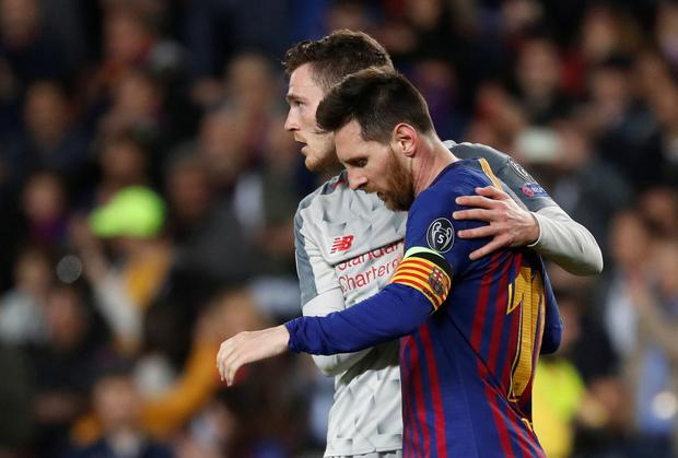 Barcelona's Lionel Messi with Liverpool's Andrew Robertson at the end of the match