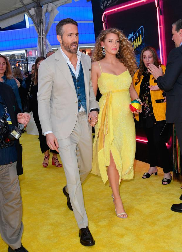 US actress Blake Lively and husband Canadian actor Ryan Reynolds attend the premiere of
