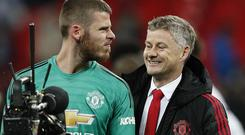 Manchester United's David de Gea jokes with Ole Gunnar Solskjaer