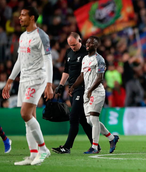 Liverpool's Naby Keita walks off injured during the UEFA Champions League semi final first leg match at the Nou Camp