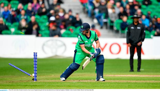 Josh Little of Ireland is bowled by Tom Curran of England during the One Day International between Ireland and England at Malahide Cricket Ground in Dublin. Photo by Sam Barnes/Sportsfile