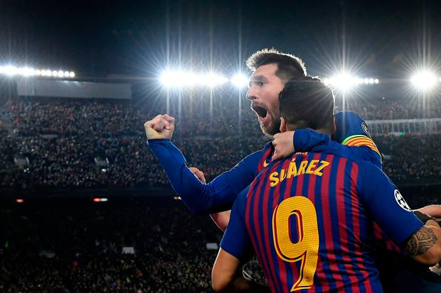 Barcelona's Argentinian forward Lionel Messi (back) celebrates with Barcelona's Uruguayan forward Luis Suarez after scoring a goal during the UEFA Champions League semi-final first leg football match between Barcelona and Liverpool at the Camp Nou Stadium. (Photo by LLUIS GENE / AFP)LLUIS GENE/AFP/Getty Images