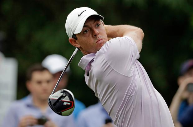 Rory McIlroy, of Northern Ireland, watches his tee shot on the 11th hole during the second round of the Wells Fargo Championship golf tournament at Quail Hollow Club in Charlotte, N.C., Friday, May 3, 2019. (AP Photo/Chuck Burton)