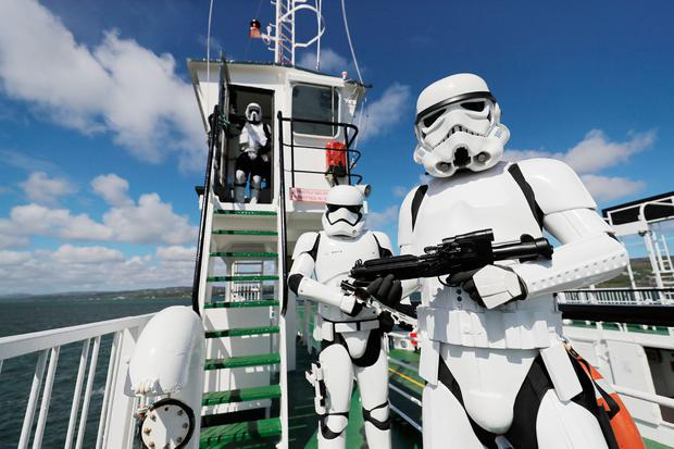 Members of the 501st Legion, Ireland Garrison (fans) arrive at Greencastle in Co Donegal, on the Lough Foyle Ferry for the May the Fourth Festival in Malin Head where scenes from 'Star Wars: The Last Jedi' where filmed. Photo: Niall Carson/PA Wire