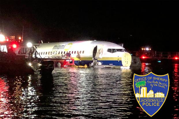 A charter plane traveling from Cuba to north Florida ended up in a river at the end of a runway (Jacksonville Sheriff's Office via AP}