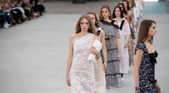 Models present creations during the 2020 Chanel Croisiere (Cruise) fashion show at the Grand Palais in Paris on May 3, 2019. (Photo by Christophe ARCHAMBAULT / AFP)