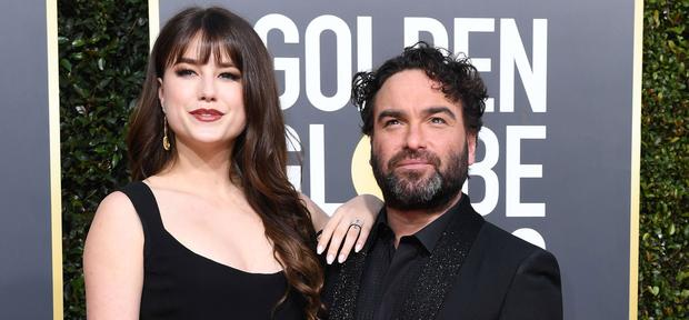 US actor Johnny Galecki (R) arrives with girlfriend Alaina Meyer for the 76th annual Golden Globe Awards on January 6, 2019, at the Beverly Hilton hotel in Beverly Hills, California. (Photo by VALERIE MACON / AFP)