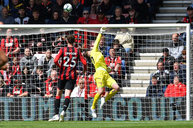 Bournemouth's English goalkeeper Mark Travers (R) saves a shot from Tottenham Hotspur's Brazilian midfielder Lucas Moura (unseen) during the English Premier League football match between Bournemouth and Tottenham Hotspur at the Vitality Stadium in Bournemouth, southern England on May 4, 2019. (Photo Credit: BEN STANSALL/AFP/Getty Images)