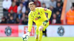 BOURNEMOUTH, ENGLAND - MAY 04: Mark Travers of Bournemouth rolls the ball out during the Premier League match between AFC Bournemouth and Tottenham Hotspur at Vitality Stadium on May 04, 2019 in Bournemouth, United Kingdom. (Photo by Warren Little/Getty Images)