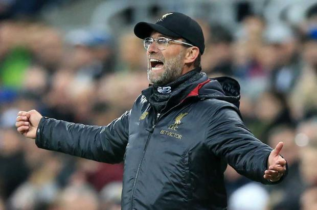 Jurgen Klopp salutes his Liverpool team as they produce a thrilling victory at Newcastle to keep the Premier League title race alive