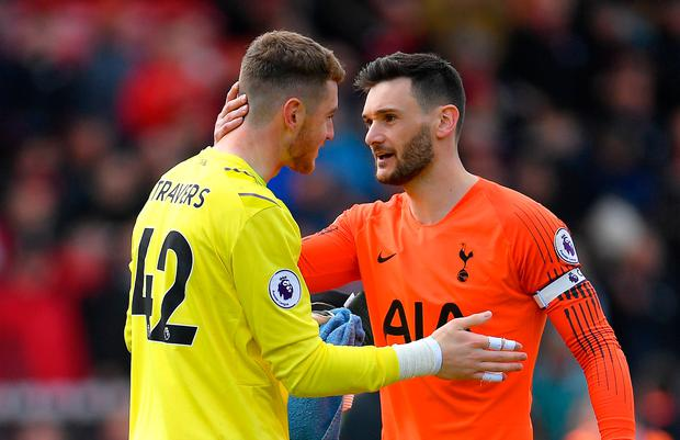 Mark Travers speaks with Hugo Lloris of Tottenham Hotspur after the match. Photo: Getty