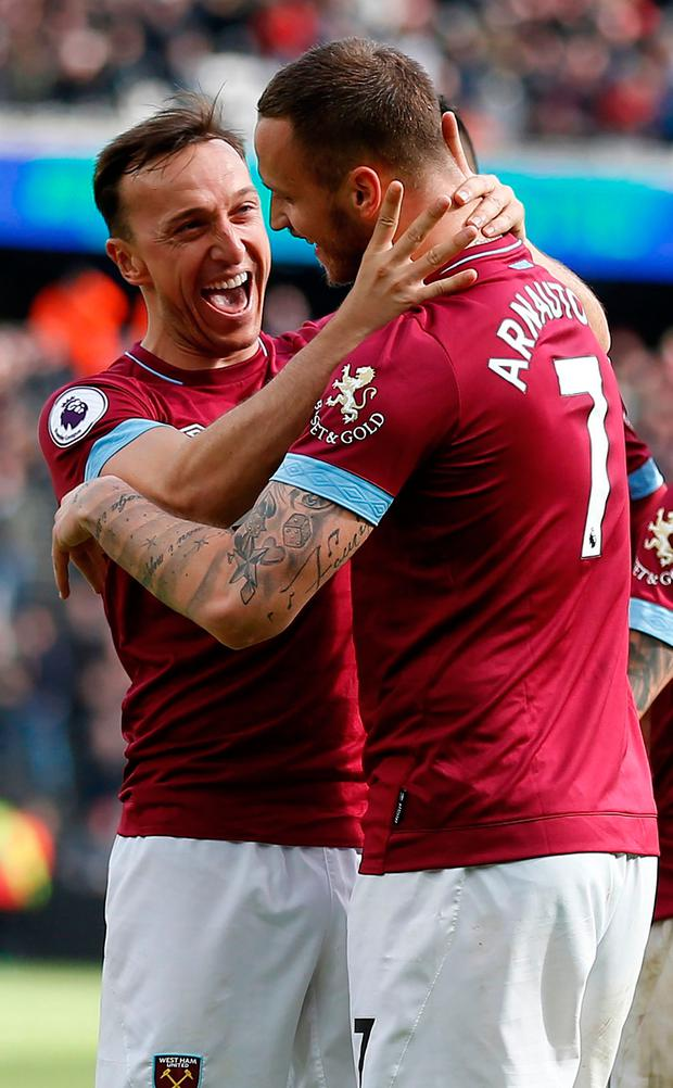 West Ham United's Marko Arnautovic (R) celebrates scoring his team's second goal with club captain Mark Noble. Photo: Getty Images