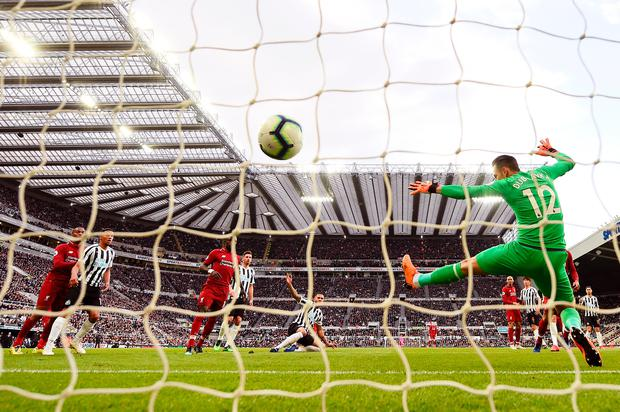 Virgil van Dijk of Liverpool scores his team's first goal. Photo: Getty