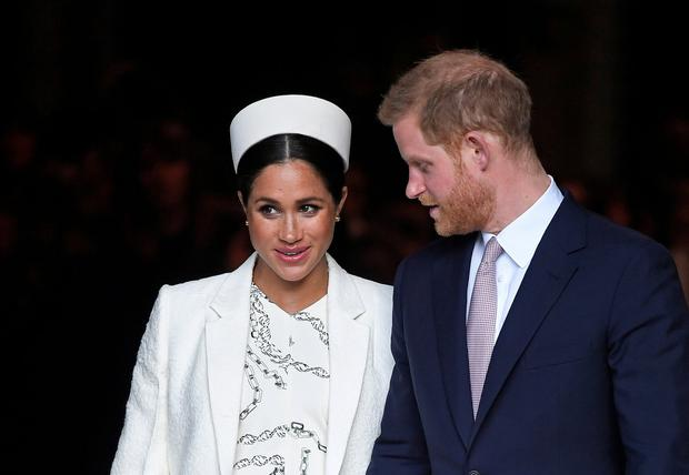 MODERN PARENTS: Meghan and Harry in March. Though Meghan is now overdue, Harry is taking off for the Netherlands next week for a couple of days on a 'major diplomatic visit'. Picture: Reuters