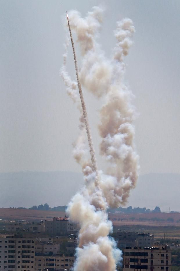 A rocket is fired from Gaza towards the Israeli city of Ashkelon yesterday. Picture: Reuters