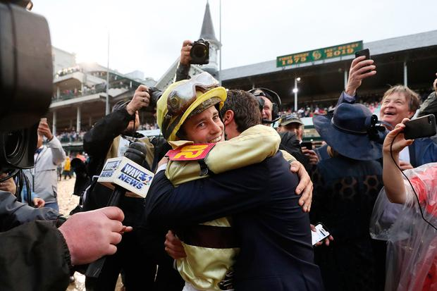Jockey Flavien Prat celebrates with the connections of Country House #20 after winning the 145th running of the Kentucky Derby at Churchill Downs on May 04, 2019 in Louisville, Kentucky. (Photo by Rob Carr/Getty Images) *** BESTPIX ***
