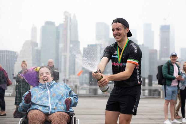 Irish runner Shane Finn with his cousin Mary Evans after completing a 5000km run across the US.