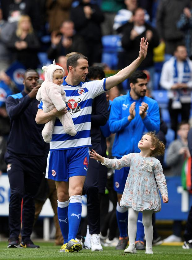 Reading's John O'Shea waves to the fans as he walks around the pitch after the match Action Images/Tony O'Brien