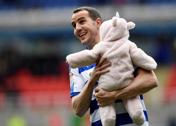 Reading's John O'Shea walks around the pitch after the match Action Images/Tony O'Brien
