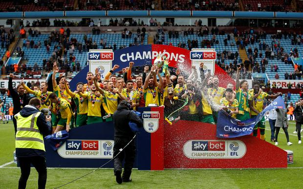 Soccer Football - Championship - Aston Villa v Norwich City - Villa Park, Birmingham, Britain - May 5, 2019 Norwich City celebrates with the trophy after winning the Championship Action Images/Andrew Boyers