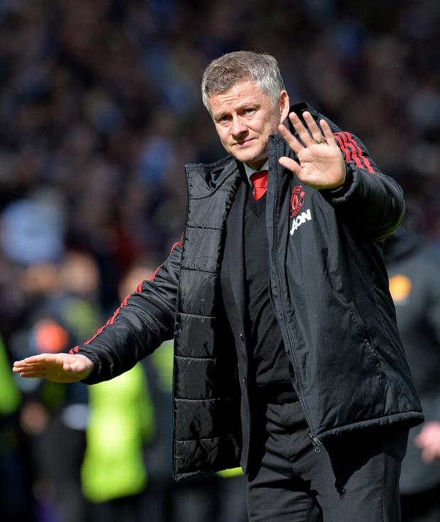 Manchester United manager Ole Gunnar Solskjaer gestures to fans after the match. REUTERS/Peter Powell