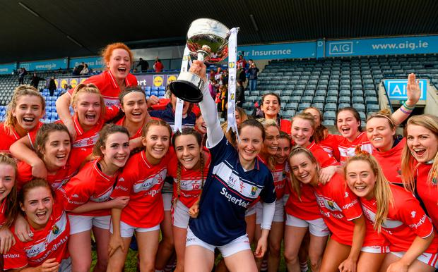 Cork captain Martina O'Brien and her team-mates celebrate with the Division 1 cup after the Lidl Ladies National Football League Division 1 Final match between Cork and Galway at Parnell Park in Dublin.