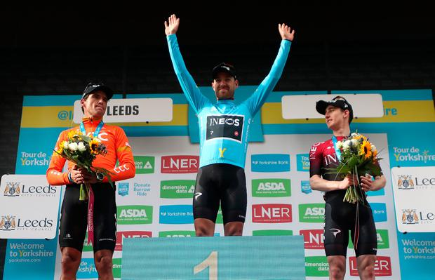 CCC's Greg Van Avermaet, Ineos' Chris Lawless and Ineos' Eddie Dunbar take to the podium. Photo: Bradley Collyer/PA Wire