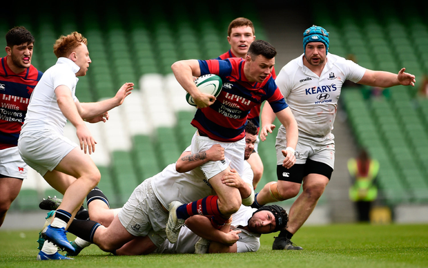 Matthew Darcy of Clontarf is tackled by Dylan Murphy and Evan Mintern of Cork Constitution. Photo by Oliver McVeigh/Sportsfile