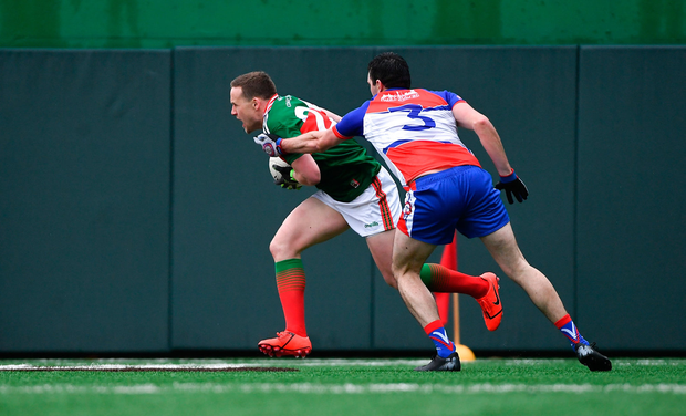 Andy Moran of Mayo in action against Gerard McCartan of New York. Photo by Piaras Ó Mídheach/Sportsfile