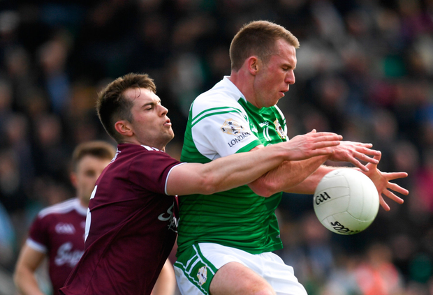Liam Gavaghan of London in action against Liam Silke of Galway. Photo by Harry Murphy/Sportsfile