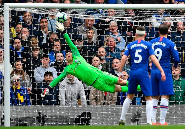 Chelsea's Spanish Kepa Arrizabalaga is at full stretch to keep the ball out. Photo: Getty Images