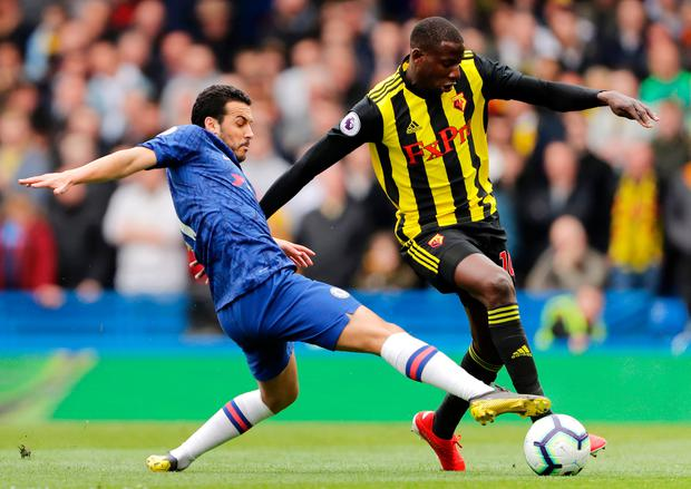 Watford's Abdoulaye Doucoure evades Chelsea's Pedro. Photo: Getty Images