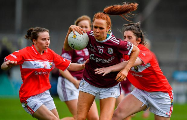 Olivia Divilly of Galway in action against Melissa Duggan and Ciara O'Sullivan of Cork. Photo by Brendan Moran/Sportsfile