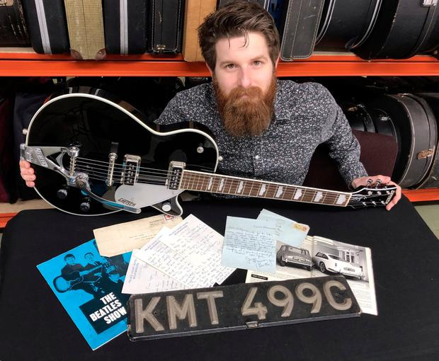 Ticket to ride: Auctioneer Luke Hobbs with a car number plate once owned by George Harrison as well as letters written by the guitarist. Photo: Gardiner Houlgate/PA Wire