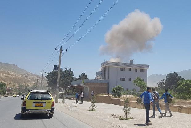 Smoke rises from the site of an attack in Pul-e-Khumri city, Baghlan province, Afghanistan. Photo: Reuters