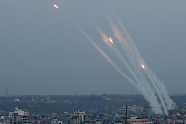 Trails: Rockets are fired from Gaza towards Israel yesterday. Photo: Reuters
