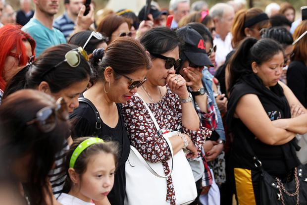 Women cry during a public vigil in memory of the victims of a suspected serial killer in the mine where two women were found dead. Photo: Reuters