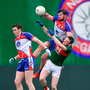 Niall Madine of New York battles for possession with Matthew Ruane of Mayo (right). Photo: Sportsfile