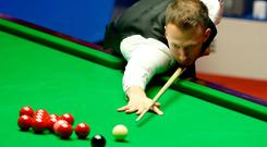 Judd Trump in action. Photo by Nigel Roddis/Getty Images