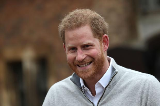 Britain's Prince Harry, Duke of Sussex, speaks to members of the media at Windsor Castle in Windsor on May 6, 2019, following the announcement that his wife Meghan, Duchess of Sussex has given birth to a son. - PIC: STEVE PARSONS/AFP/Getty Images